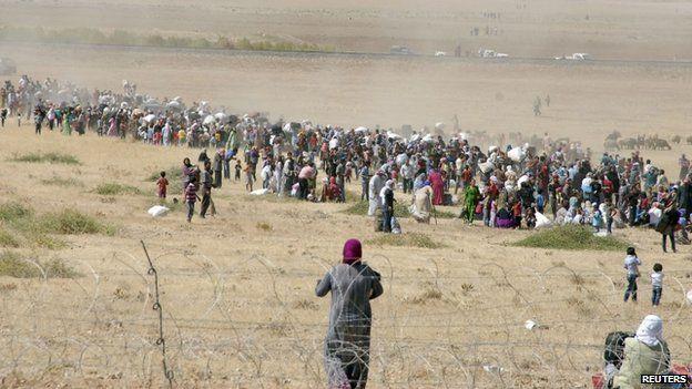 Turkey troops use tear gas to clear Syrians